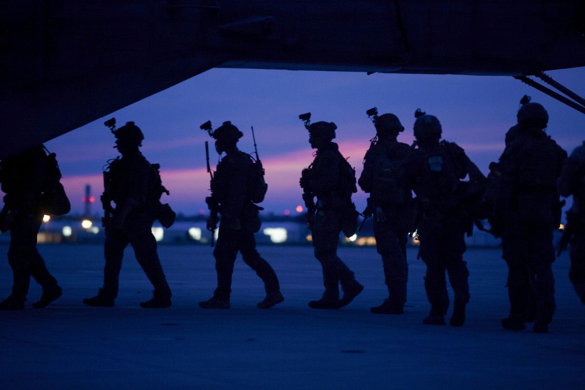 Silhouettes of Marines in front of a sunset