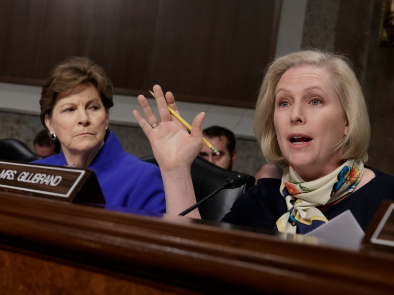 """Sen. Kirsten Gillibrand, D-N.Y., joined at left by Sen. Jeanne Shaheen, D-N.H., questions Marine Gen. Robert B. Neller, the commandant of the Marine Corps, at a Senate Armed Services Committee hearing on the investigation of nude photographs of female Marines and other women that were shared on the Facebook page """"Marines United,"""" on Capitol Hill in Washington, Tuesday, March, 14, 2017."""