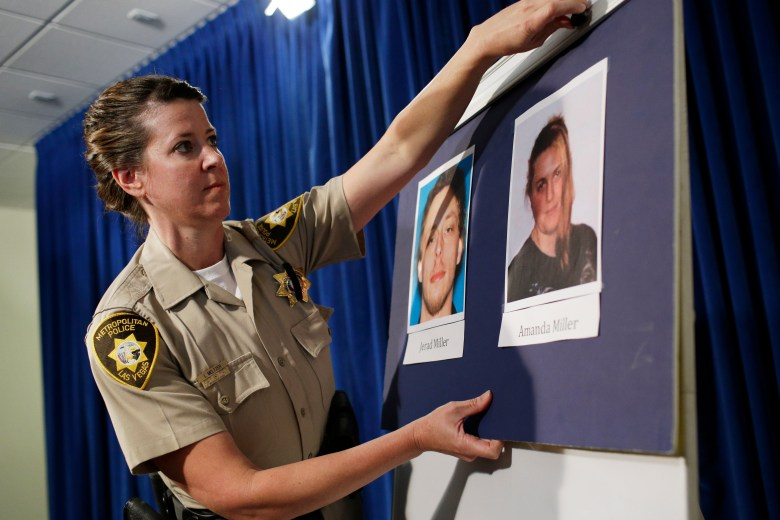 """Las Vegas police Officer Laura Meltzer displays photos of Patriot movement extremists Jerad and Amanda Miller before a news conference June 9, 2014. The day before, the couple gunned down two police officers in a pizzeria, leaving a swastika and """"Don't tread on me"""" flag on one victim, before killing a civilian who attempted to intervene."""