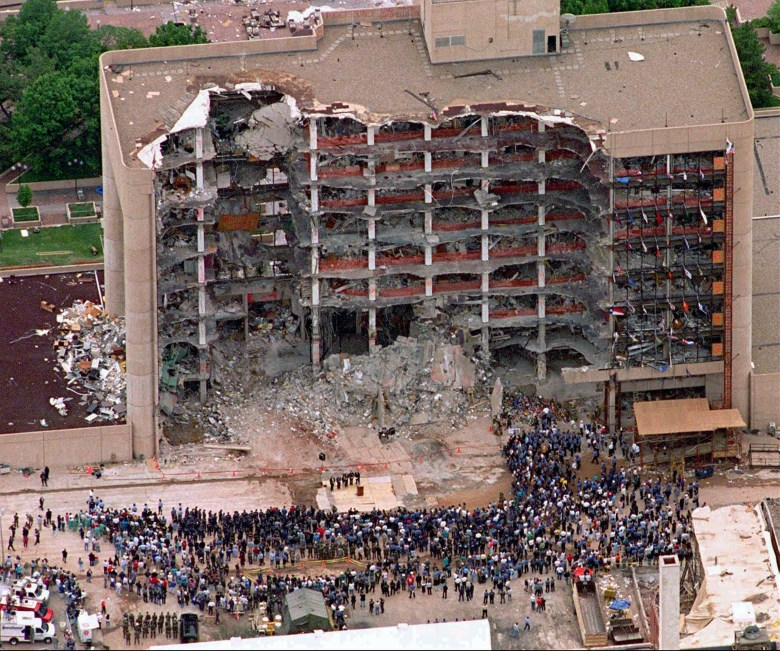 Search and rescue crews attend a memorial service in front of the Murrah Federal Building in Oklahoma City on May 5, 1995. The bombing by domestic terrorist Timothy McVeigh killed 168 people and injured 680.