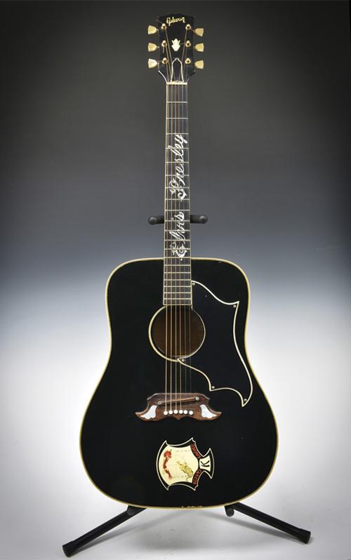 Elvis Presleys Gibson Ebony Dove Heads To Auction