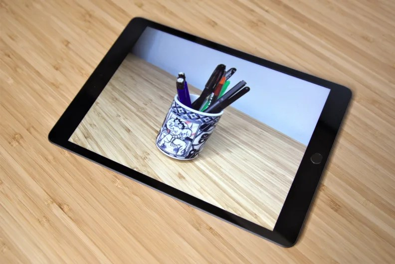An Apple iPad used to display a photo.