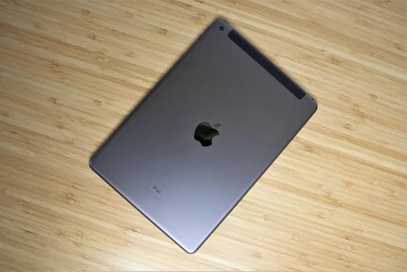 An Apple iPad face-down on a desk.