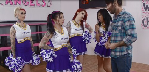 Screen shot from VAMPIRE CHEERLEADERS. Joanna Angel second from left, Tommy Pistol at right.