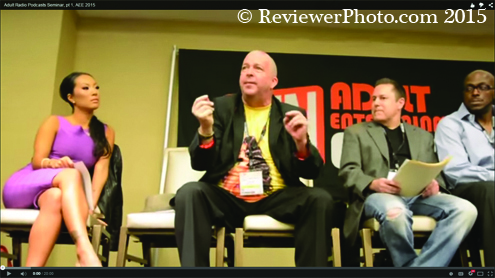 Stars and industry heavies during the panel discussions dispensed porn biz knowledge. This is a frame from a Reviewer.TV video of a panel discussion about porn radio. Photos of AEE 2015 are on ReviewerPhoto.com, with a lot more inside the upcoming print issue on page five.