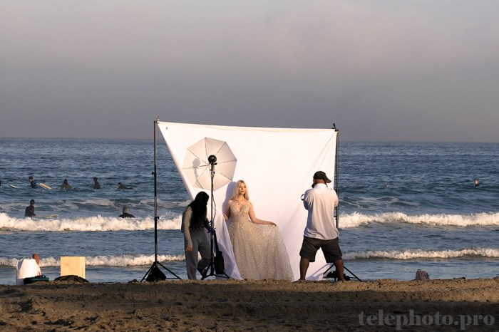 They were doing a solo-bridal photoshoot on the beach.