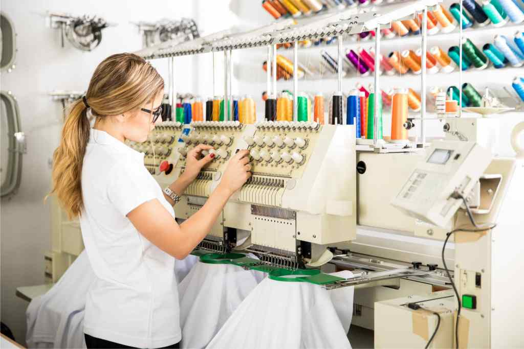 Kathleen Reid checking Yarn for review round best embroidery machine for beginners
