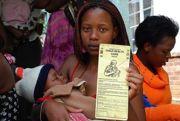 Sindiso Marume holding her brother's health card. Image credit irinnews.org