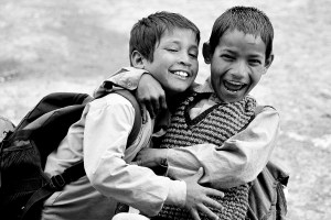 two boys embracing and smiling and laughing
