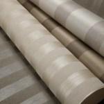 La colección Manhattan de revestimientos tiene relieve en hoja metálica y glassbeads sobre hilos de lino, se puede instalar horizontal o verticalmente, en High Class Technology.