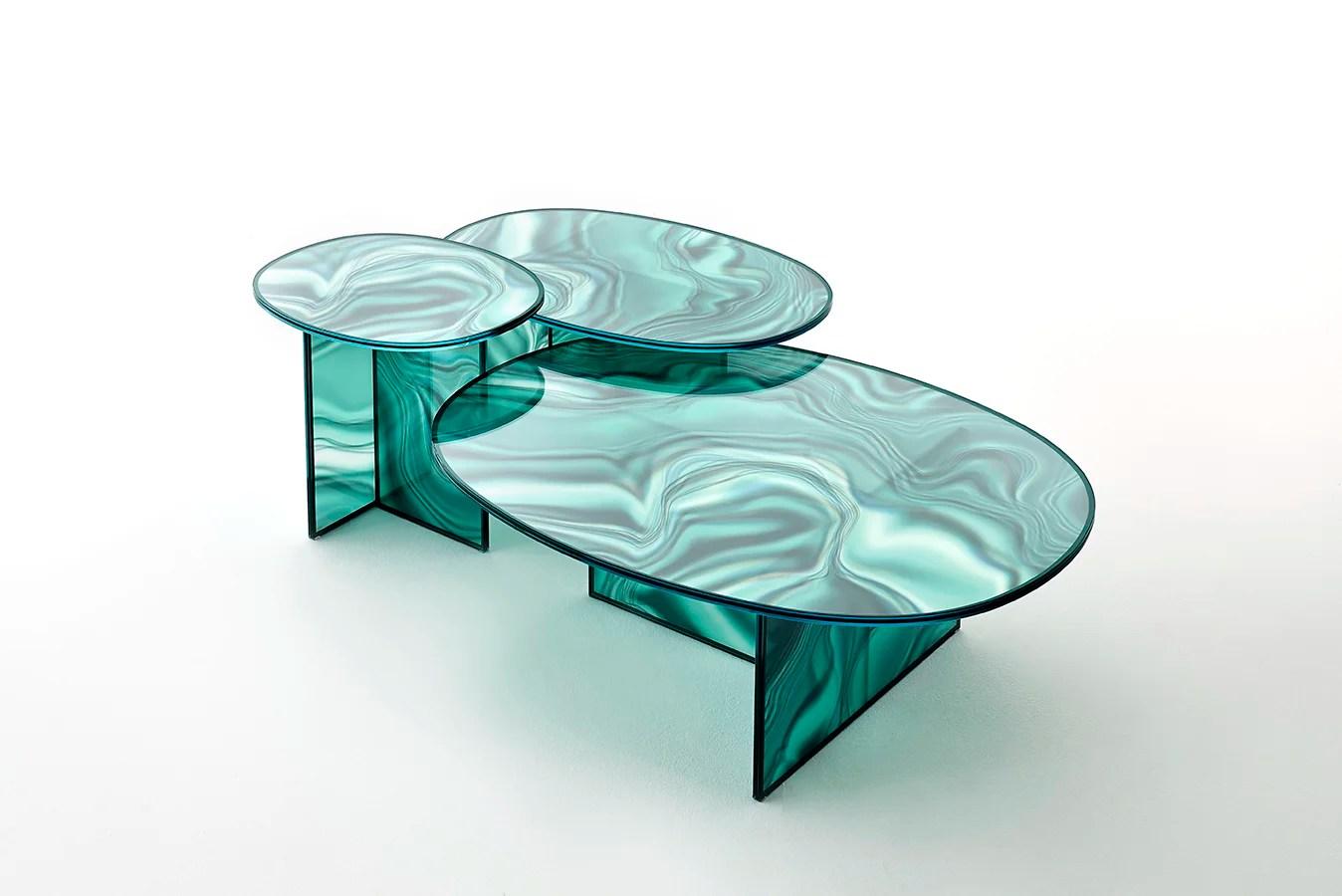 Patricia Urquiola , Las mesas liquefy de vidrio templado, producidas por Glas Italia, son un diseño de la española Patricia Urquiola. Cuentan con un tratamiento especial que simula la textura del mármol con la ligereza y lo translúcido del vidrio.