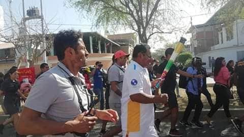 Genner Gutiérrez portando la antorcha de los juegos Panamericanos - Lima 2019