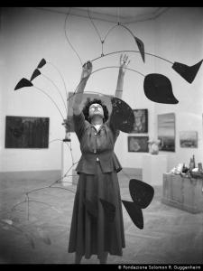 Peggy Guggenheim with Alexander Calder's Arc of petals at the 1948 Venice Biennale