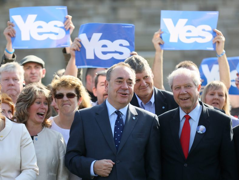 Scotland's First Minister Alex Salmond poses for a photograph with Jim Sillars as they campaign in Edinburgh, Scotland