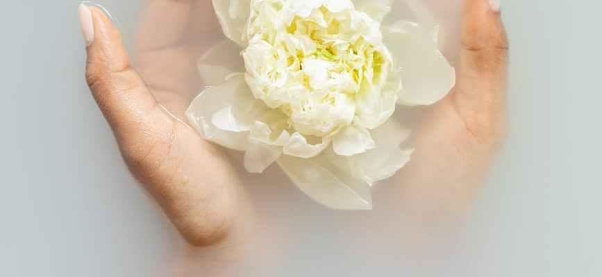 gentle woman with flower in hands