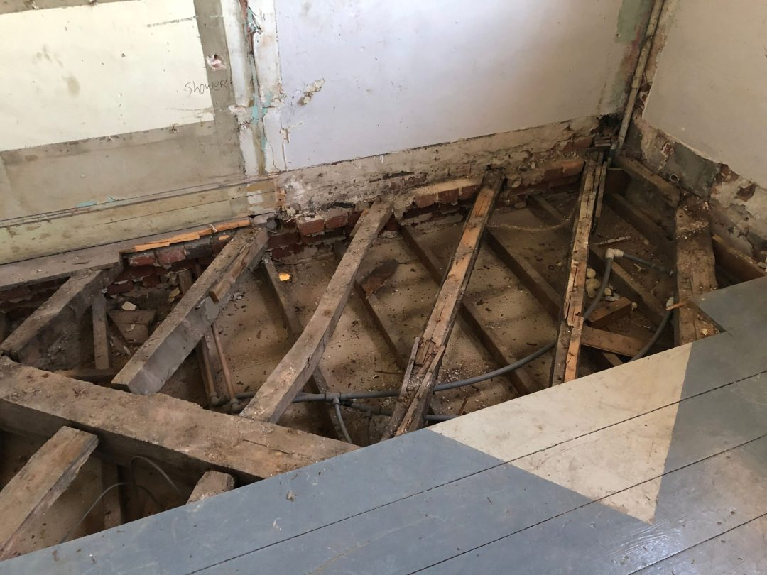 Floor joists exposed in Country Hall