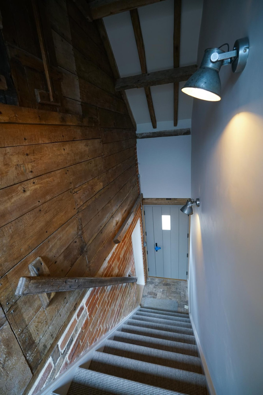 Carriage House Original Wood Panelling reused as wall covering