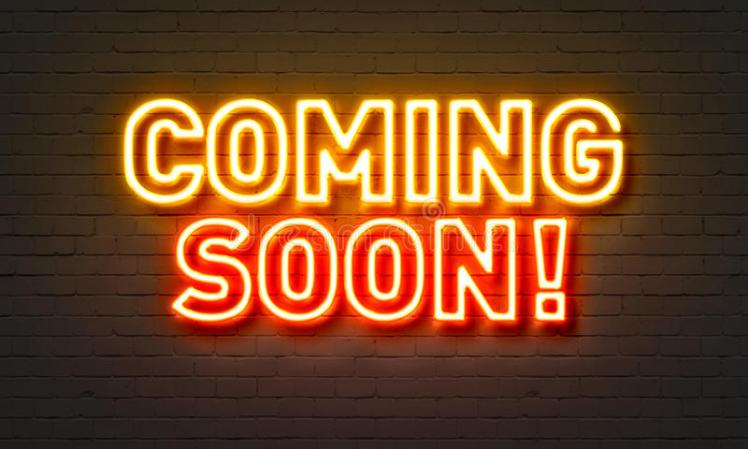 coming-soon-neon-sign-brick-wall-background-87865865