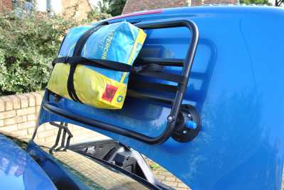 Revo Rack Mercedes SLK R170 Luggage Rack with a bag of cement on it, boot open