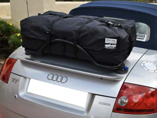 bmw z4 luggage rack e89 with a revo-rack fitted with a boot-bag vacation on it