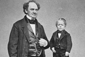 P. T. Barnum, circus producer, stands next to a table on which Charles Stratton, a dwarf who came to be known as Tom Thumb, stands. Barnum hired Stratton at the age of five and Stratton became the first major attraction the circus owner promoted. --- Image by © Bettmann/CORBIS