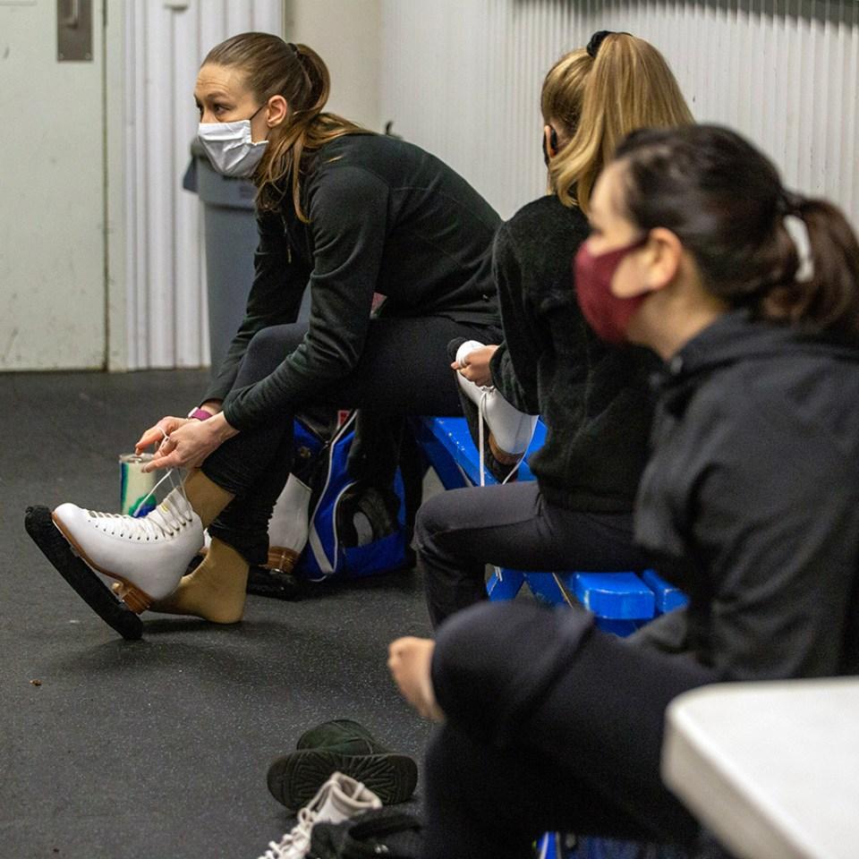 Revolution Ice Unity teammates put on skates