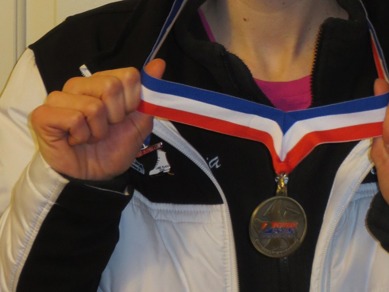 RIU synchro skater mentors and wears gold medal.