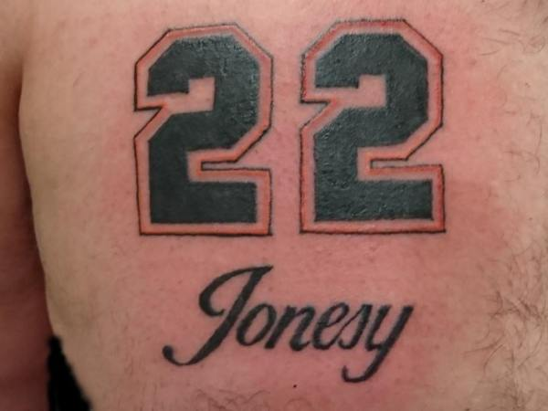 Jersey number & script tattoo by Dana