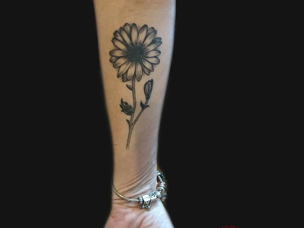 daisy black & grey flower forearm tattoo by Dana