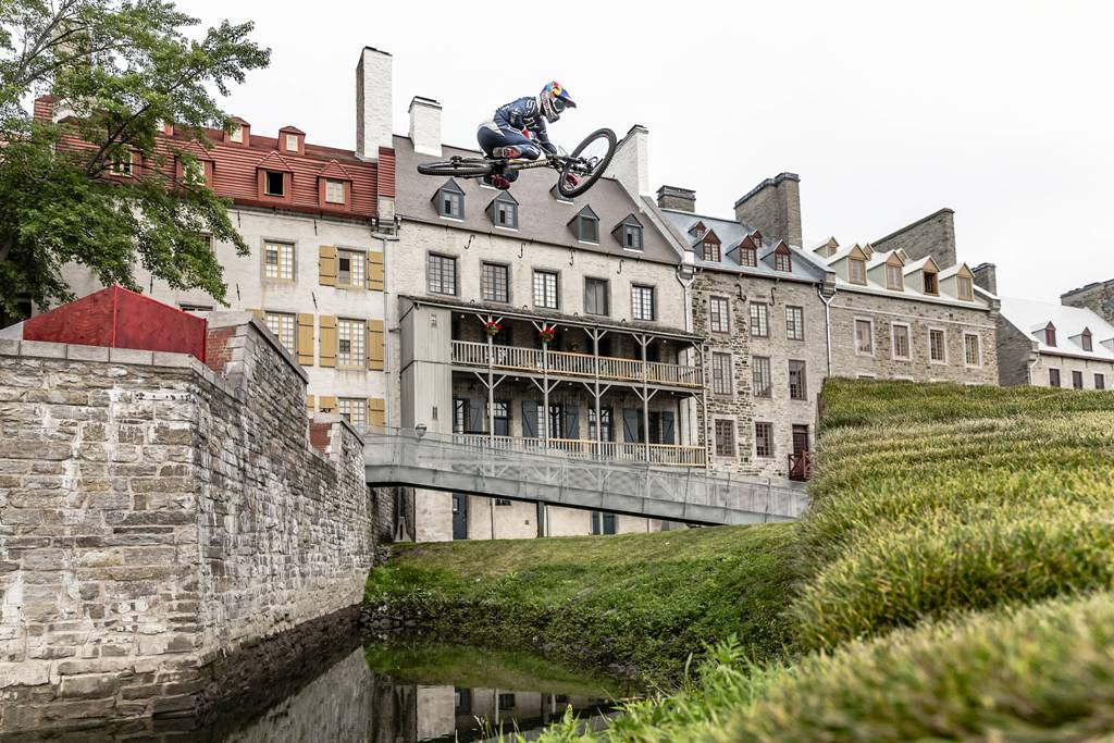 Finn Iles catches air on his downhill mountain bike during the making of Red Bull Purest Line in Quebec City, Canada on July 21, 2017. // Scott Serfas / Red Bull Content Pool // P-20170809-00151 // Usage for editorial use only // Please go to www.redbullcontentpool.com for further information. //