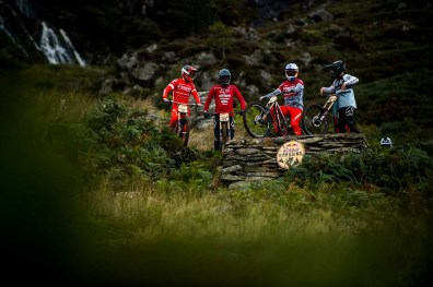Riders convene on the take-off of a jump at Redbull Hardline September 2018, Dinas Mawddwy, Wales.