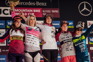 Winners stand on the podium at UCI DH World Cup in Val di Sole, Italy