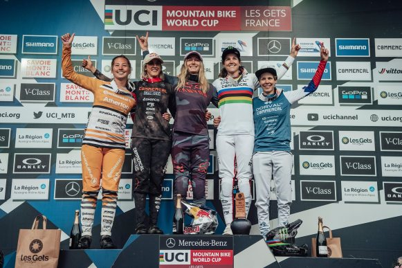 Mille Johnset (4th), Myriam Nicole (2nd), Tahnee Seagrave (1st), Camille Balanche (3rd) and Monika Hrastnik (5th) are seen on the podium at UCI DH World Cup in Les Gets, France on July 3rd, 2021
