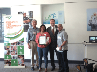 Caltrans' Oakland office receives their certificate of completion from Daniel Hamilton, Sustainability Manager of Oakland.