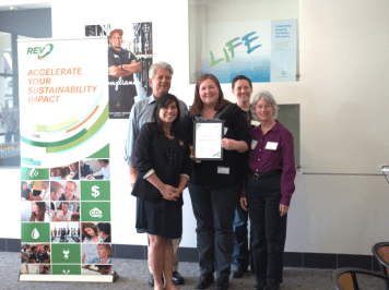 The City of Emeryville receives their certificate of completion from Dianne Martinez, Mayor of Emeryville.