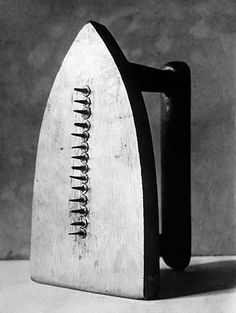 Duchamp: Iron. In this image the artist has utilised the object