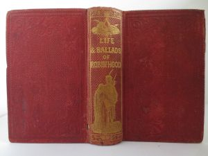 """""""The Life and Ballads of Robin Hood: And Robin Hood's Garland"""" (1865). 19th century cloth bound cover and spine, embossed in gold lettering."""