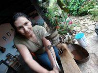 Organic farm posada owner prepping fresh ground coffee