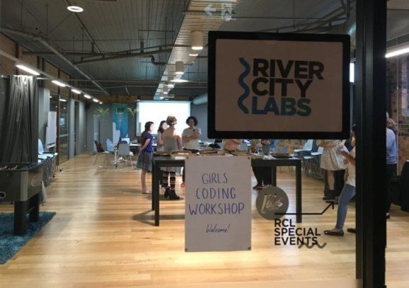 The view into River City Labs where the Brisbane girls coding workshop was held, with the girls and leaders chatting at the pizza lunch