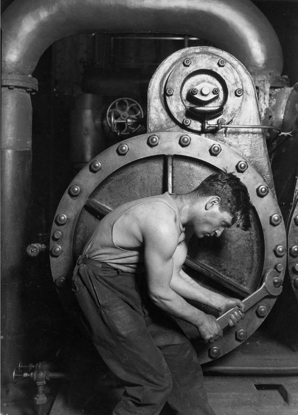 """Power house mechanic working on steam pump"" By Lewis Hine, 1920"