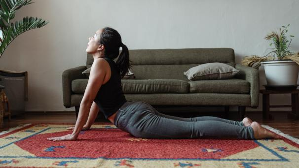 Woman stretching - How to cope with stress - RGU Student Blog