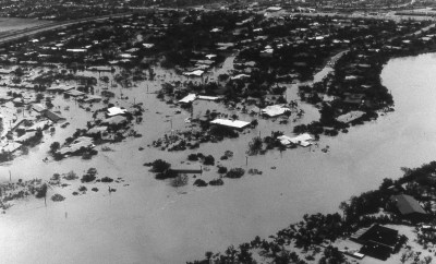 Aerial photograph showing Harlingen's airport and Arroyo Colorado in the aftermath of Hurricane Beulah. Circa 1967.