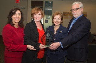 """From left: Denise Berger; Mary Lee Hannell, Chief Human Capital; Lillian Borrone, Keynote Speaker and Pat Foye, Port Authority Executive Director Pat Foye. Borrone received the Port Authority """"First International Women's Day Award"""""""