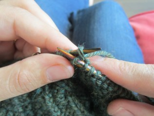 Pull the yarn through the stitch