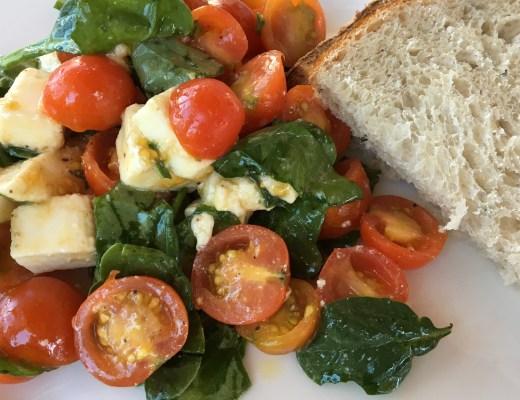 Caprese salad: Tomatoes, mozzarella, basil, spinach, olive oil