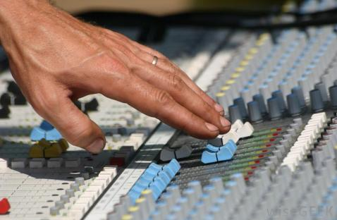 sound-engineer-hands-on-mixing-desk