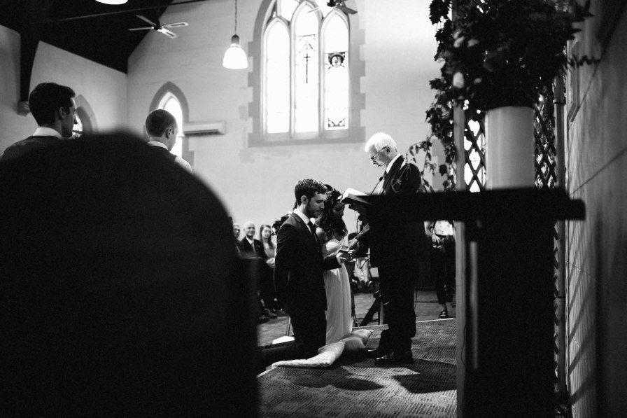 A bride & groom receiving an anglican blessing at their Subiaco wedding.