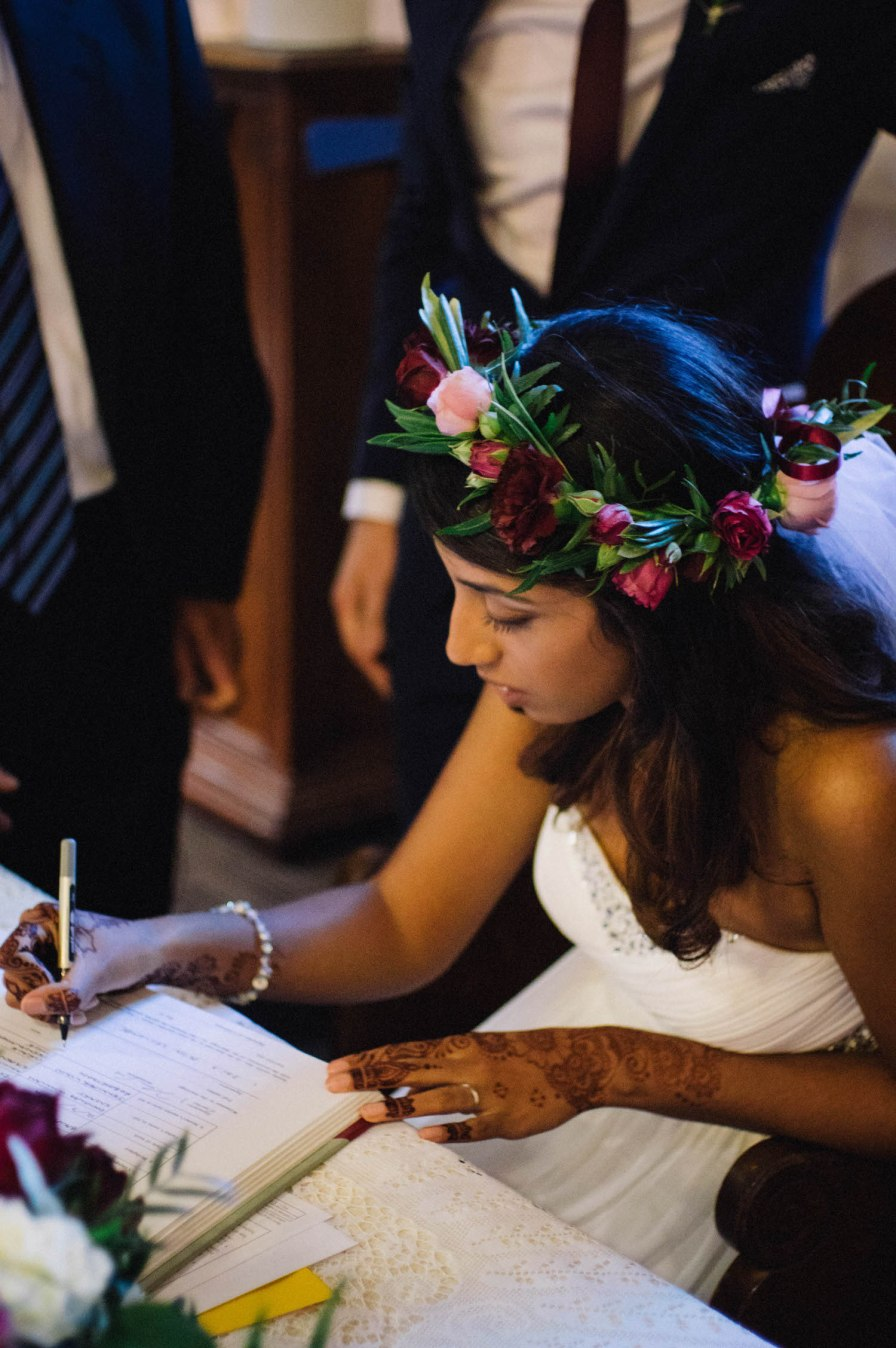 An Indian-Canadian bride signing the register at St Matthew's Anglican church in Perth, Australia.