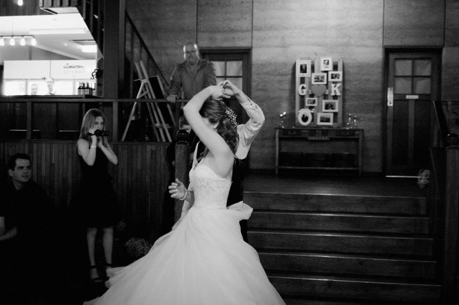 The groom spins his bride during their first dance at Quarry Farm.