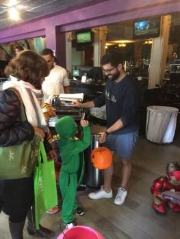 Merchants handing out treats to the kids